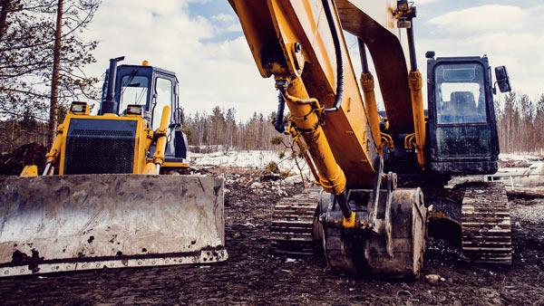 bulldozer och grävmaskin för dränering