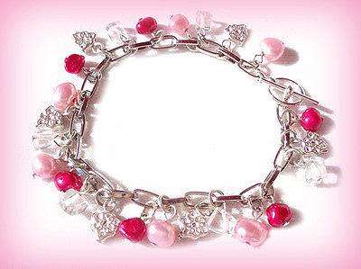 Rasselarmband med rosa sötvattenspärlor