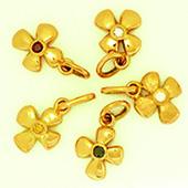 Guldblommor med diamant i olika färg