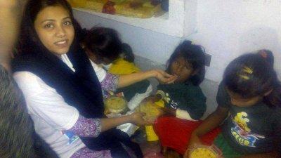 The Christian Sunday school teacher feeding a KKC child