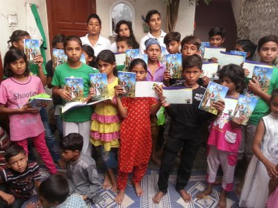 A couple of kids in KKC F-city in Pakistan received kid-bibels written in Urdu