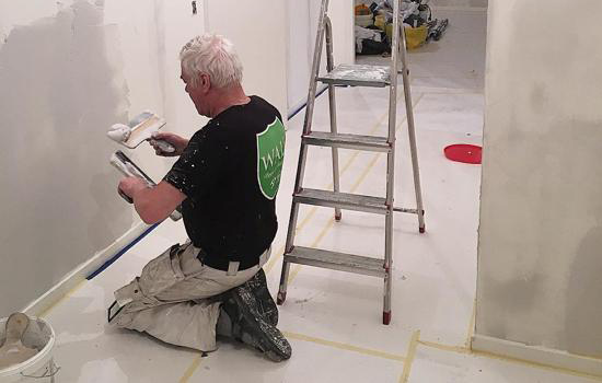 walls målare arbetar