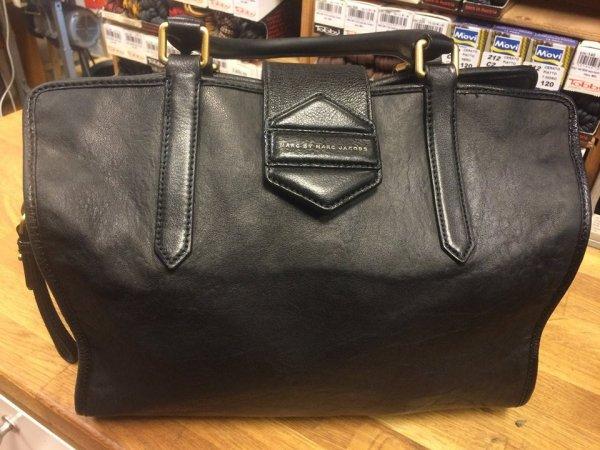 Lädervård handväska