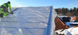 Arbete med väderskydd.