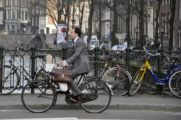 Business man in Amsterdam by Aude