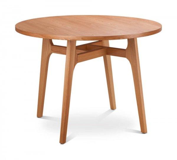 Litet runt bord på vitt golv